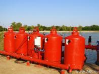 Гравийная фильтостанция АИК  на берегу накопителя